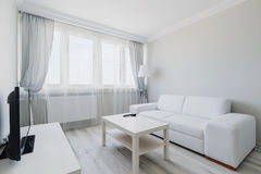 Cosy light living room. Photo of cosy light living room with simple furniture Stock Photos