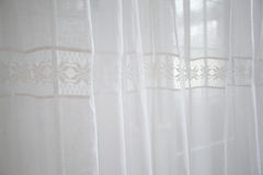 Cosy light white curtains with the hemstitch. Window design. Cosy light white curtains with the hemstitch Royalty Free Stock Photo