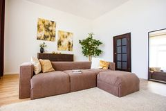 Cosy living room decorated with stylish elements. Contemporary decoration in apartment stock images