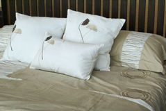 Cosy pillows on bed. Cosy bed with pillows and bed cover royalty free stock photos