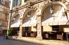 Cosy restaurant in of a typical Venetian building in Kerkyra city on the island of Corfu, Greece. Royalty Free Stock Photography