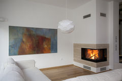 Cosy room. Fireplace in bright and contemporary living room royalty free stock image