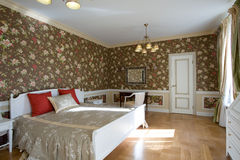 Cosy spacious bedroom. Cosy light bedroom in country cottage Stock Image