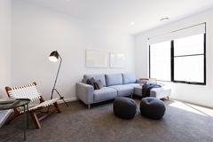 Cosy tv sitting room in a new Australian home. Cosy tv sitting room with corner lounge suite in a new Australian home royalty free stock photography
