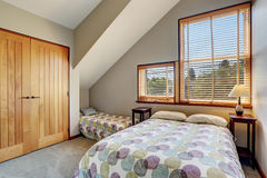 Cosy upstairs bedroom with minimal design and closet. Stock Image