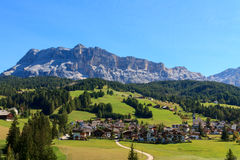 Cosy village on foot of the mountain. Of the Dolomites,in Italy Stock Image