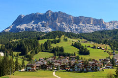 Cosy village on foot of the mountain. Of the Dolomites,in Italy Royalty Free Stock Photo