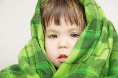 Cosy warm blanket furnishing, child portrait Royalty Free Stock Images