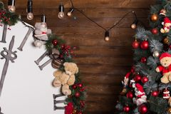 Cosy warm room decorated for Christmas Eve. Christmas tree, gifts and packs on background. Family holidays stock image