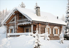 Cosy winter house. Covered with snow Royalty Free Stock Photos