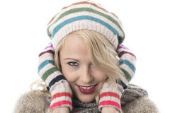 Cosy Young Woman Wearing Hat and Gloves Royalty Free Stock Photos