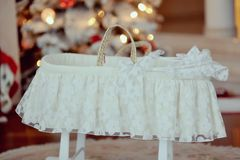 Cot under the Christmas tree Stock Photography