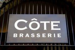Cote Brasserie Restaurant Sign. LONDON, UK - JUNE 7TH 2015: A sign for a Cote Brasserie Restaurant in central London on 7th June 2015 Royalty Free Stock Image