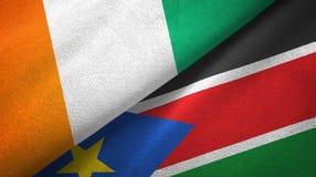 Cote d ?Ivoire y pa?o del sur de la materia textil de las banderas de Sud?n dos, textura de la tela stock de ilustración