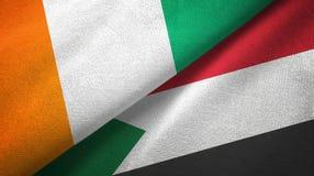 Cote d ?pa?o de la materia textil de las banderas de Ivoire y de Sud?n dos, textura de la tela libre illustration