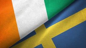Cote d ?pa?o de la materia textil de las banderas de Ivoire y de Suecia dos, textura de la tela ilustración del vector