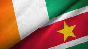 Cote d ?pa?o de la materia textil de las banderas de Ivoire y de Suriname dos, textura de la tela libre illustration