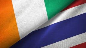 Cote d ?pa?o de la materia textil de las banderas de Ivoire y de Tailandia dos, textura de la tela stock de ilustración