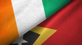 Cote d ?pa?o de la materia textil de las banderas de Ivoire y de Timor-Leste Timor Oriental dos, textura de la tela stock de ilustración
