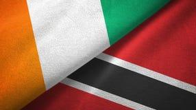 Cote d ?pa?o de la materia textil de las banderas de Ivoire y de Trinidad and Tobago dos, textura de la tela stock de ilustración