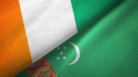 Cote d ?pa?o de la materia textil de las banderas de Ivoire y de Turkmenist?n dos, textura de la tela ilustración del vector