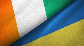 Cote d ?pa?o de la materia textil de las banderas de Ivoire y de Ucrania dos, textura de la tela stock de ilustración