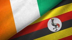 Cote d ?pa?o de la materia textil de las banderas de Ivoire y de Uganda dos, textura de la tela libre illustration