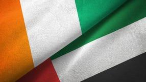 Cote d ?pa?o de la materia textil de las banderas de Ivoire y de United Arab Emirates dos, textura de la tela stock de ilustración