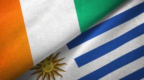 Cote d ?pa?o de la materia textil de las banderas de Ivoire y de Uruguay dos, textura de la tela libre illustration