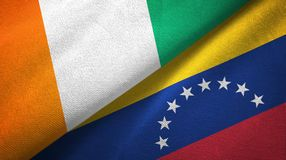 Cote d ?pa?o de la materia textil de las banderas de Ivoire y de Venezuela dos, textura de la tela libre illustration