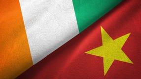 Cote d ?pa?o de la materia textil de las banderas de Ivoire y de Vietnam dos, textura de la tela libre illustration