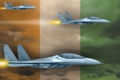 Cote d Ivoire air forces strike concept. Air planes attack on Cote d Ivoire flag background. 3d Illustration. Cote d Ivoire air strike concept. Modern war Royalty Free Stock Photo