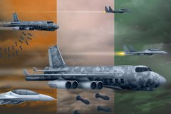 Cote d Ivoire air forces bombing strike concept. Cote d Ivoire army air planes drop bombs on flag background. 3d Illustration. Cote d Ivoire bomb air strike Royalty Free Stock Photos
