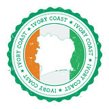 Cote D`Ivoire map and flag in vintage rubber. Royalty Free Stock Image