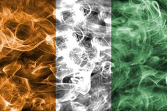 Cote d`Ivoire smoke flag. Isolated on a black background Stock Photo