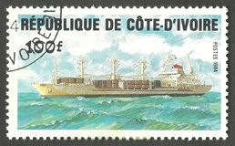 Marine themes, Cargo ship. Cote d`Ivoire - stamp printed in1984, Multicolor Edition of Marine themes, Series Ships, Cargo ship Stock Image