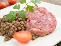 Cotechino and lentils Stock Photos