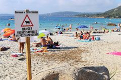 Coti Chiavari, Corsica, France. 20th July 2016. The beach. A sign warning at the beach Stock Images