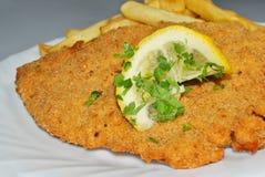 Cotoletta con le patate fritte Fotografie Stock