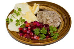 Cotoletta con le verdure sul piatto Fotografia Stock