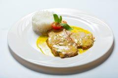 Cotoletta della carne di maiale con la salsa ed il riso di curry Immagini Stock Libere da Diritti