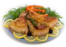 Cotolette e limone del pollo Fotografie Stock