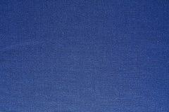 Cotonou. Blue Cotonou shot closeup. Solid seamless texture. Textile industry Royalty Free Stock Images
