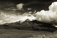 Cotopaxi. Cloud covered Cotopaxi volcano in Ecuador, sepia toned Royalty Free Stock Photos