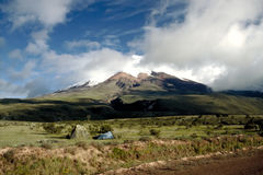 Cotopaxi - Ecuador. A small tent is guarded by Cotopaxi, the highest active volcano in the world (5.897m Stock Image