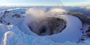 Cotopaxi summit with smoking crater Royalty Free Stock Photo