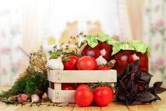 Cotos hechos en casa de los tomates Fotografía de archivo libre de regalías