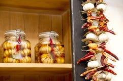 Cotos hechos en casa y pimientas secadas Foto de archivo libre de regalías