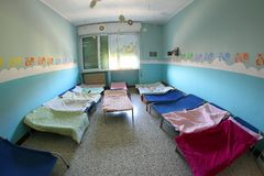 COTS with blankets for children in the nursery dormitory Royalty Free Stock Photos