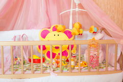 Cots with different soft toys Stock Image